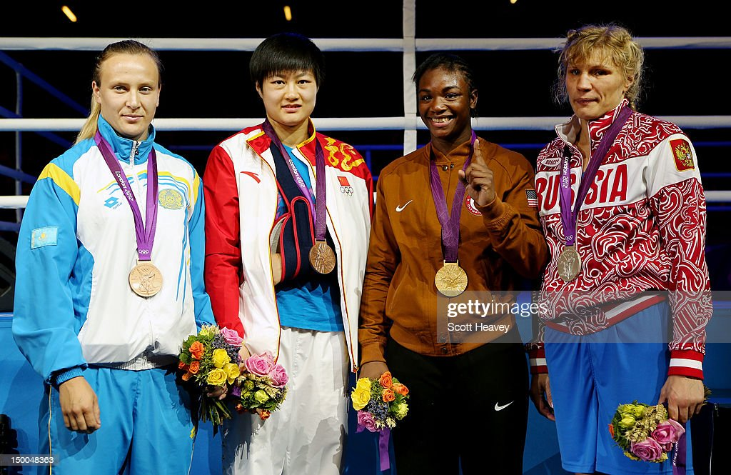 Bronze medalist <a gi-track='captionPersonalityLinkClicked' href=/galleries/search?phrase=Marina+Volnova&family=editorial&specificpeople=9327767 ng-click='$event.stopPropagation()'>Marina Volnova</a> of Kazakhstan, bronze medalist Jinzi Li of China, gold medalist <a gi-track='captionPersonalityLinkClicked' href=/galleries/search?phrase=Claressa+Shields&family=editorial&specificpeople=8936937 ng-click='$event.stopPropagation()'>Claressa Shields</a> of the United States and silver medalist <a gi-track='captionPersonalityLinkClicked' href=/galleries/search?phrase=Nadezda+Torlopova&family=editorial&specificpeople=9403778 ng-click='$event.stopPropagation()'>Nadezda Torlopova</a> of Russia pose during the medal ceremony for the Women's Middle (75kg) Boxing final bout on Day 13 of the London 2012 Olympic Games at ExCeL on August 9, 2012 in London, England.