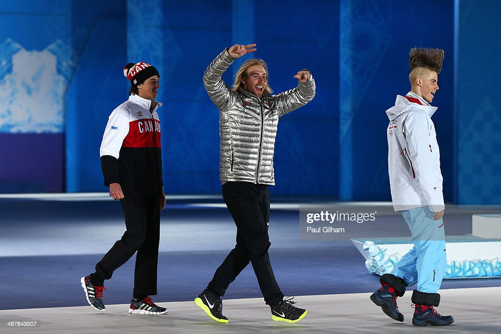 Bronze medalist <a gi-track='captionPersonalityLinkClicked' href=/galleries/search?phrase=Mark+McMorris&family=editorial&specificpeople=7354910 ng-click='$event.stopPropagation()'>Mark McMorris</a> of Canada, gold medalist <a gi-track='captionPersonalityLinkClicked' href=/galleries/search?phrase=Sage+Kotsenburg&family=editorial&specificpeople=6711370 ng-click='$event.stopPropagation()'>Sage Kotsenburg</a> of the United States and silver medalist Staale Sandbech of Norway joke as they make their way to the podium during the medal ceremony for the for the Snowboard Men's Slopestyle during day 1 of the Sochi 2014 Winter Olympics at Medals Plaza on February 8, 2014 in Sochi, Russia.