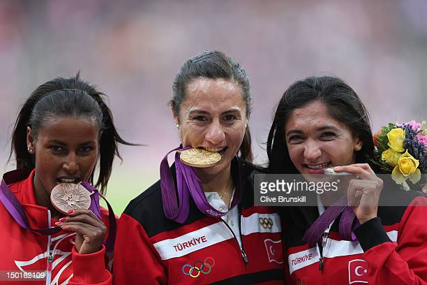 Bronze medalist Maryam Yusuf Jamal of Bahrain gold medalist Asli Cakir Alptekin of Turkey and Silver medalist Gamze Bulut of Turkey pose on the...