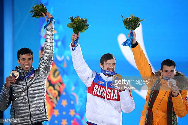 Bronze medalist Matthew Antoine of United States gold medalist Alexander Tretiakov of Russia and Silver medalist Martins Dukurs of Latvia celebrate...