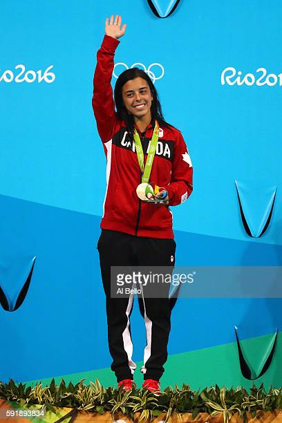 Bronze medalist Meaghan Benfeito of Canada celebrates on the podium during the medal ceremony for the Women's 10m Platform final diving contest at...