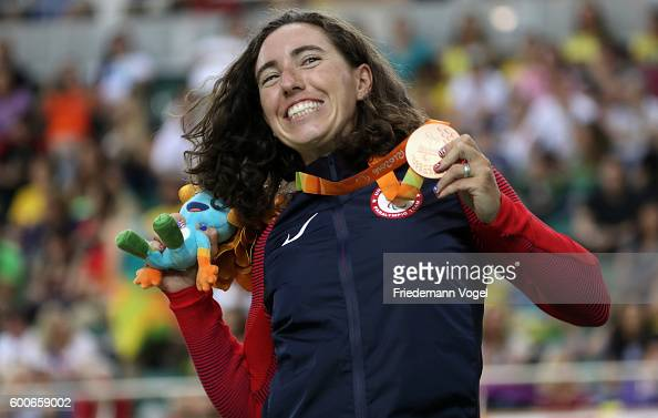 Bronze medalist Megan Fisher of the USA celebrates on the podium at the medal ceremony for the womens C4 3000m individual pursuit track cycling on...