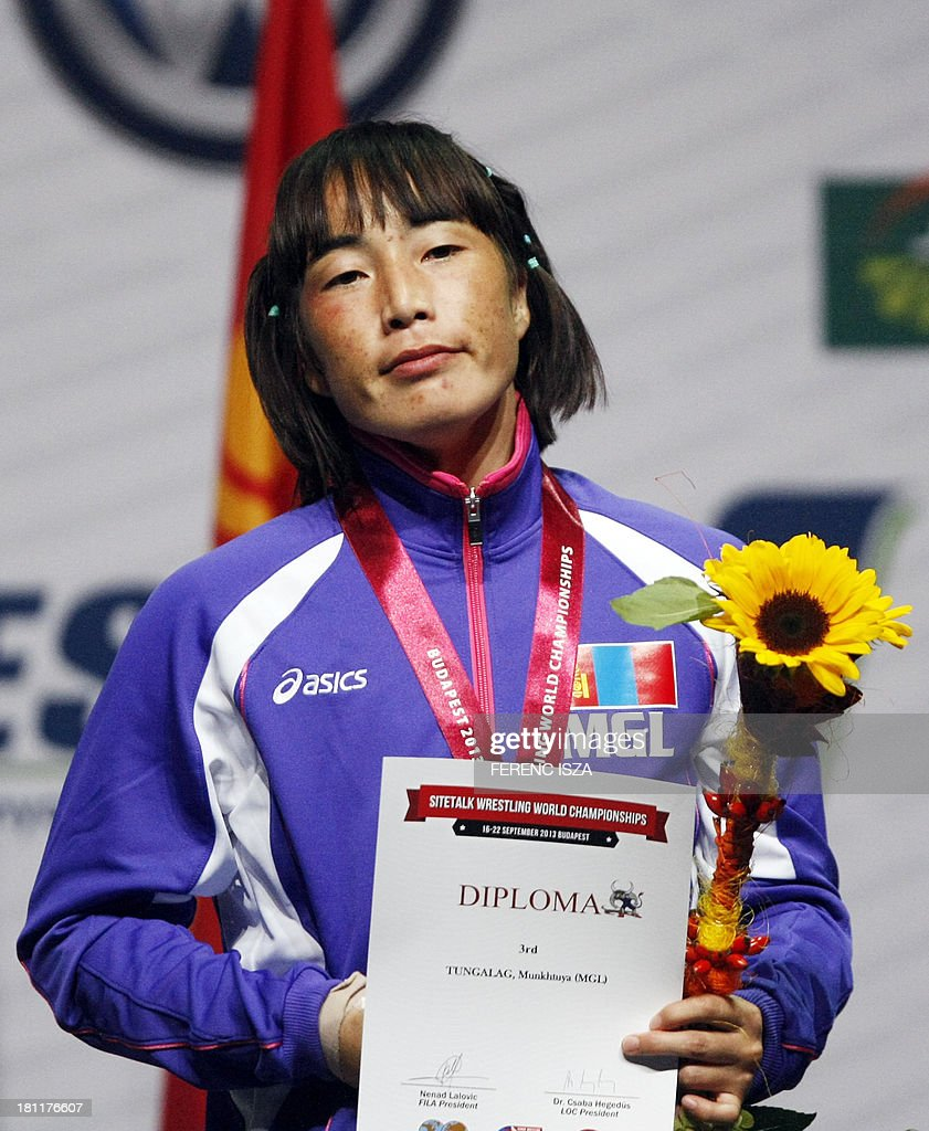 Bronze medalist Mongolia's Munkhtuya Tungalag celebrates on the podium of the women's free style 59 kg category of the World Wrestling Championships in Budapest on September 19, 2013.