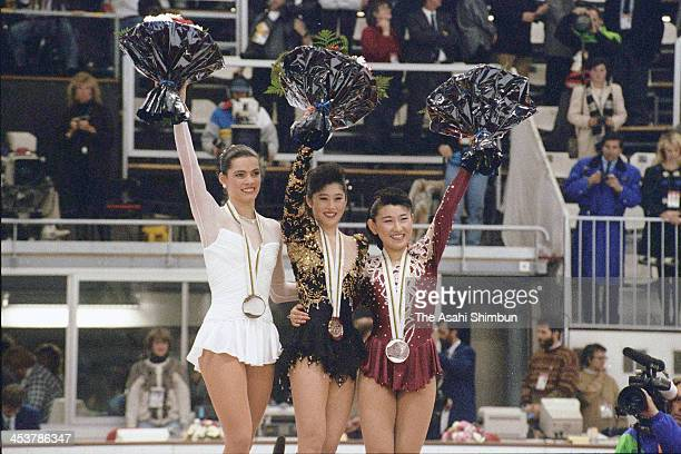 Bronze medalist Nancy Kerrigan of USA gold medalist Kristi Yamaguchi of USA and silver medalist Midori Ito of Japan pose on the podium after...
