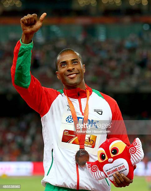 Bronze medalist Nelson Evora of Portugal poses on the podium during the medal ceremony for the Men's Triple Jump final during day seven of the 15th...