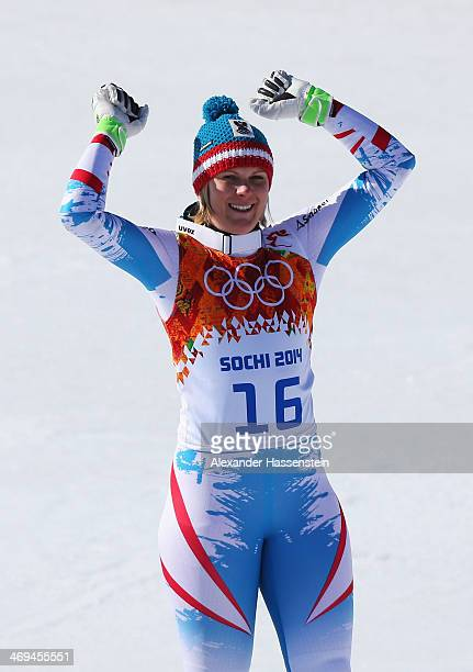 Bronze medalist Nicole Hosp of Austria celebrates on the podium during the flower ceremony for the Alpine Skiing Women's SuperG on day 8 of the Sochi...