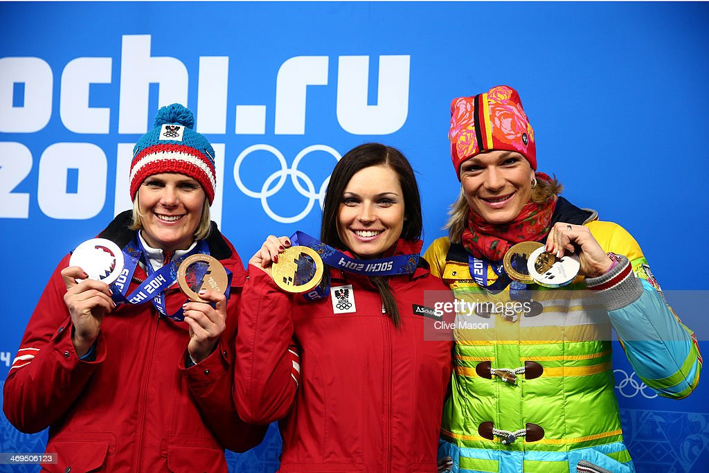 Bronze medalist Nicole Hosp of Austria, gold medalist Anna Fenninger of Austria and Silver medalist Maria Hoefl-Riesch of Germany celebrate during the medal ceremony for the Alpine Skiing Ladies' Super-G on day 8 of the Sochi 2014 Winter Olympics at Medals Plaza on February 15, 2014 in Sochi, Russia.