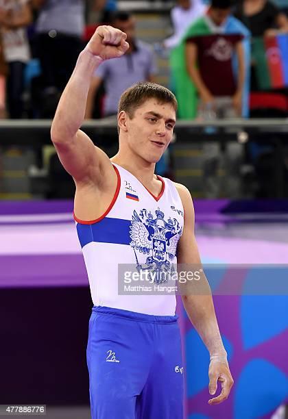 Bronze medalist Nikita Ignatyev of Russia celebrates prior to receiving the medal won during the Men's Gymnastics Horizontal Bar final on day eight...