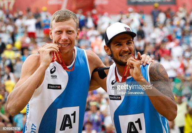 Bronze medalist Nikita Liamin and Viacheslav Krasilnikov of Russia pose for the photo during the medal ceremony for the Men's Final on August 06 2017...