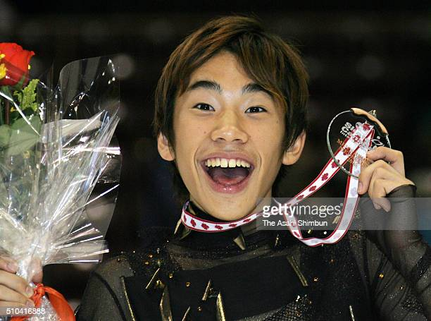 Bronze medalist Nobunari Oda of Japan celebrates on the podium at the medal ceremony for the Men's Free Programe during day three of the Skate Canada...