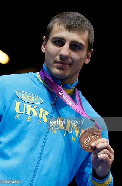 Bronze medalist Oleksandr Gvozdyk of the Ukraine celebrates during the Light heavyweight boxing awards ceremony of the 2012 London Olympic Games at...