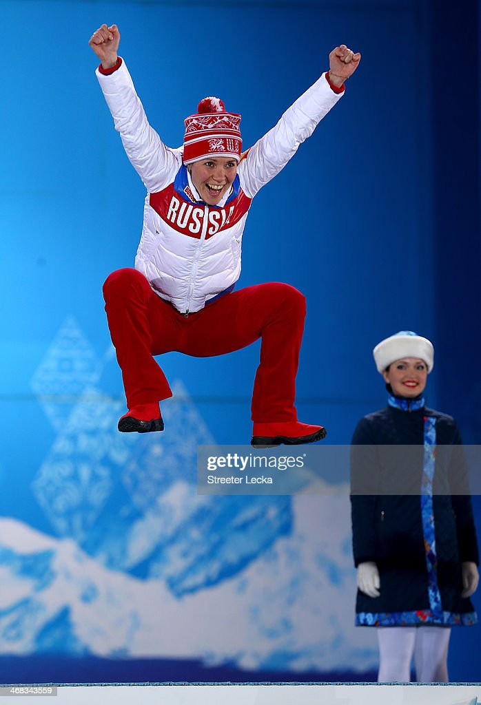 Bronze medalist <a gi-track='captionPersonalityLinkClicked' href=/galleries/search?phrase=Olga+Graf&family=editorial&specificpeople=8696814 ng-click='$event.stopPropagation()'>Olga Graf</a> of Russia celebrates during the medal ceremony for the Ladies' 3000m speed skating on day 3 of the Sochi 2014 Winter Olympics at Medals Plaza in the Olympic Park on February 10, 2014 in Sochi, Russia.