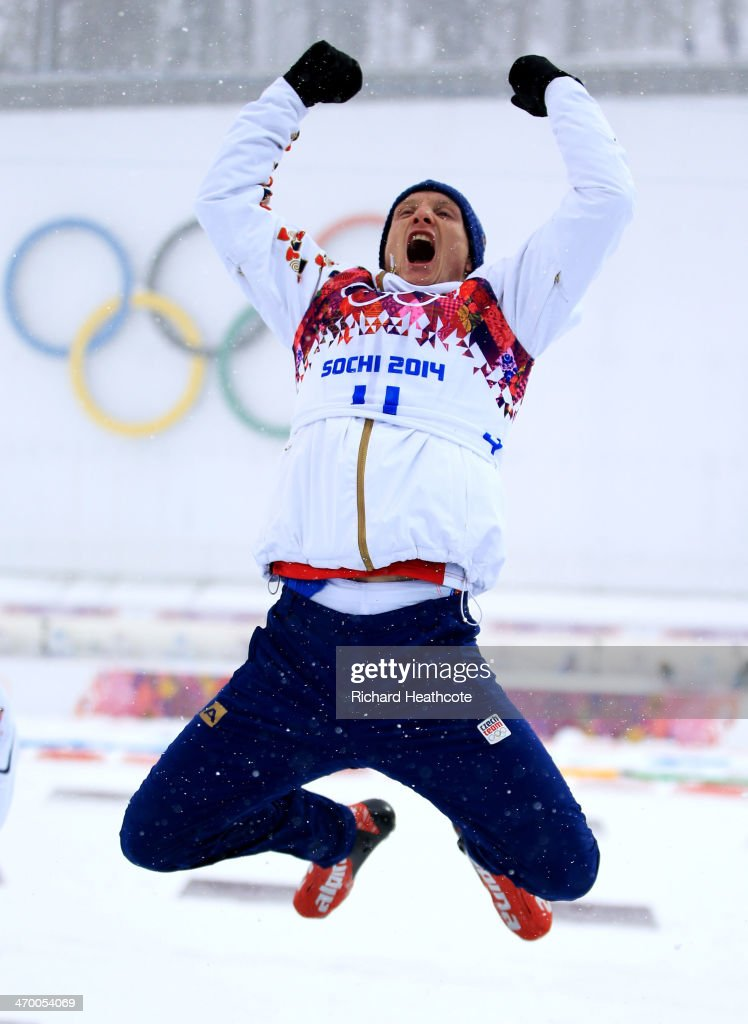 Bronze medalist Ondrej Moravec of the Czech Republic celebrates on the podium during the flower ceremony for the Men's 15 km Mass Start during day 11 of the Sochi 2014 Winter Olympics at Laura Cross-country Ski & Biathlon Center on February 18, 2014 in Sochi, Russia.