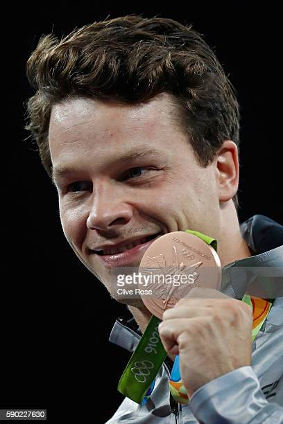 Bronze medalist Patrick Hausding of Germany poses during the medal ceremony for the Men's Diving 3m Springboard final at the Maria Lenk Aquatics...