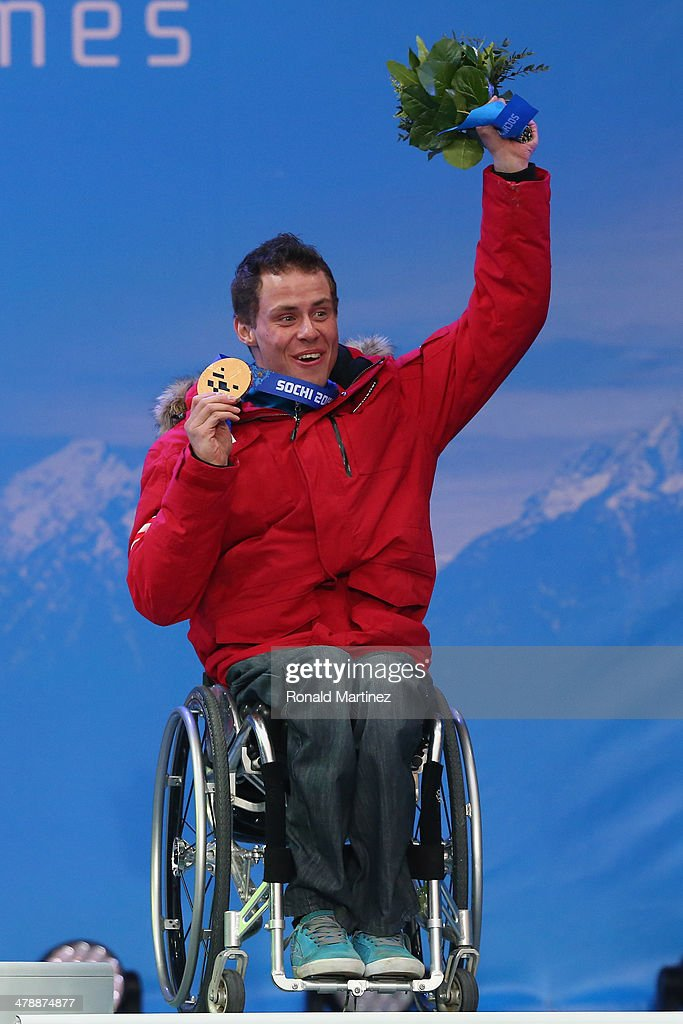 Bronze medalist Roman Rabl of Austria celebrates at the medal ceremony for men's Super Combined Sitting on day eight of the Sochi 2014 Paralympic Winter Games at Laura Cross-country Ski & Biathlon Center on March 15, 2014 in Sochi, Russia.