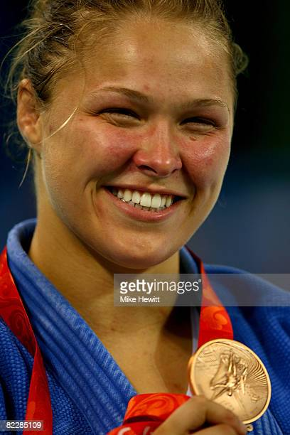 Bronze medalist Ronda Rousey of the USA stands on the podium during the medal ceremony for the Women's 70 kg judo competition at the University of...