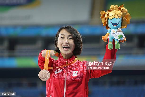 Bronze medalist Sae Tsuji of Japan celebrates on the podium at the at the medal ceremony for the Women's 400m T47 on day 7 of the Rio 2016 Paralympic...