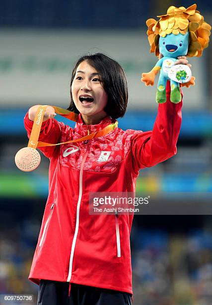 Bronze medalist Sae Tsuji of Japan celebrates on the podium at the medal ceremony for the Women's 400m T47 on day 7 of the 2016 Rio Paralympic Games...