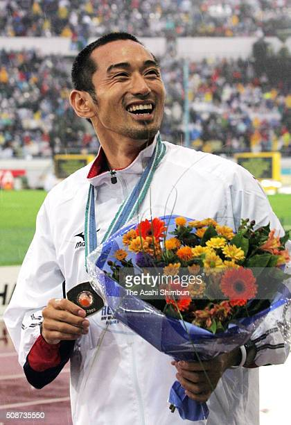 Bronze medalist Shingo Suetsugu of Japan celebrates after the medal ceremony for the Men's 400m Hurdles during day six of the IAAF World...