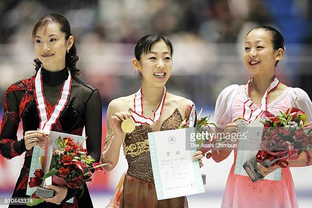 Bronze medalist Shizuka Arakawa gold medalist Fumie Suguri and silver medalist Mao Asada celebrate on the podium at the medal ceremony for the...