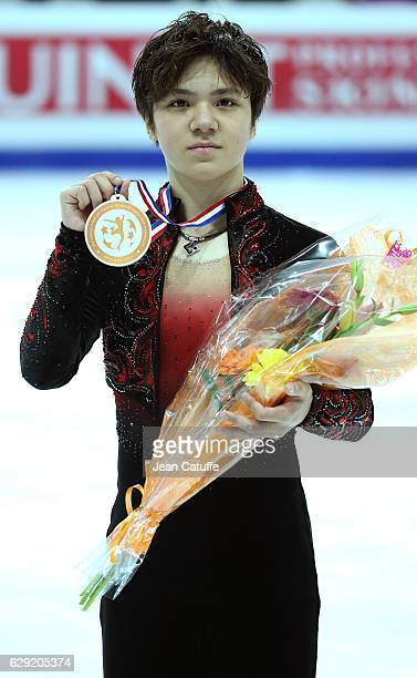 Bronze medalist Shoma Uno of Japan poses during Senior Men's medal ceremony on day three of the ISU Grand Prix of Figure Skating 2016 at Palais...
