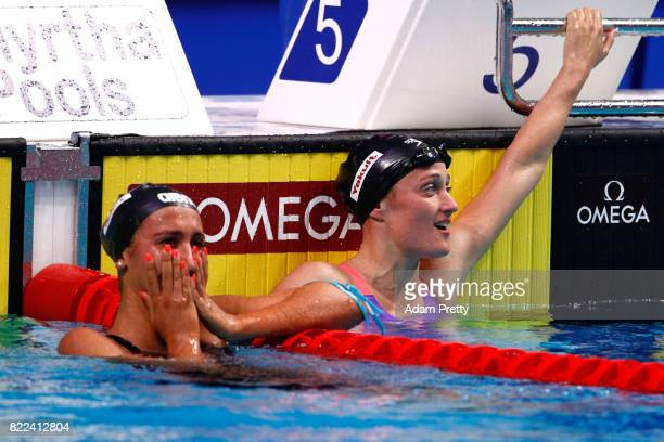 Bronze medalist Simona Quadarella of Italy and silver medalist Mireia Belmonte of Spain celebrate following the Women's 1500m Freestyle final on day...