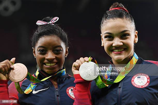 Bronze medalist Simone Biles and silver medalist Lauren Hernandez of the United States pose for photographs after the at the medal ceremony for the...