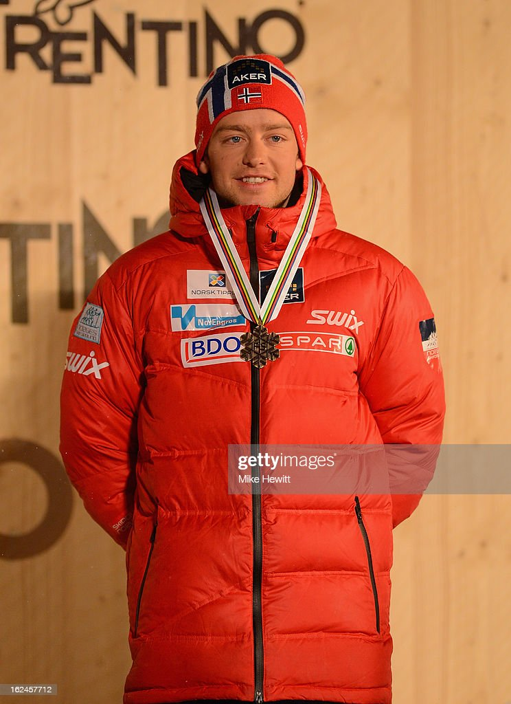 Bronze medalist Sjur Roethe of Norway poses at the medal ceremony for the Men's Skiathlon at the FIS Nordic World Ski Championships on February 23, 2013 in Val di Fiemme, Italy.