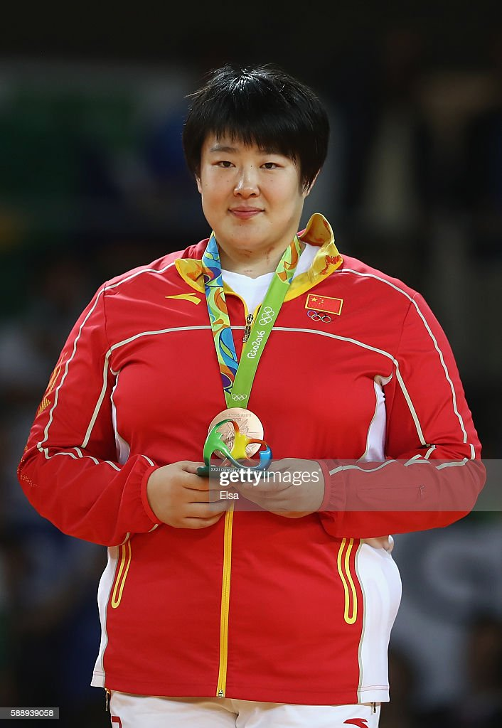 Bronze medalist Song Yu of China celebrates on the podium after the Women's 78kg Judo contest on Day 7 of the Rio 2016 Olympic Games at Carioca Arena...