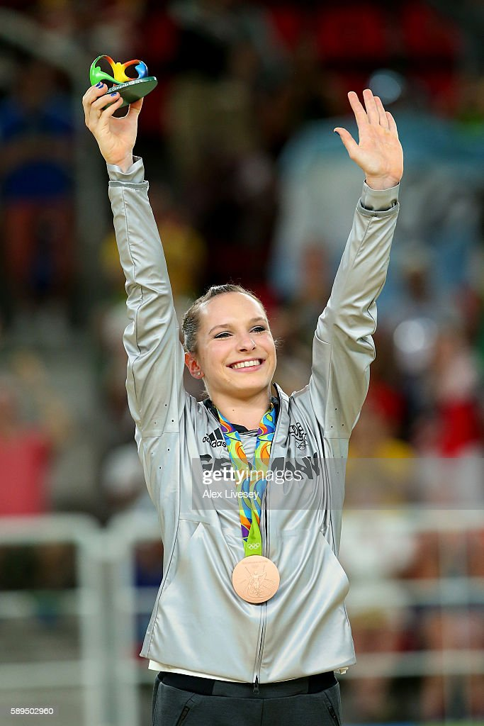 Bronze medalist Sophie Scheder of Germany celebrates on the podium at the medal ceremony for the Women's Uneven Bars on Day 9 of the Rio 2016 Olympic Games at the Rio Olympic Arena on August 14, 2016 in Rio de Janeiro, Brazil.