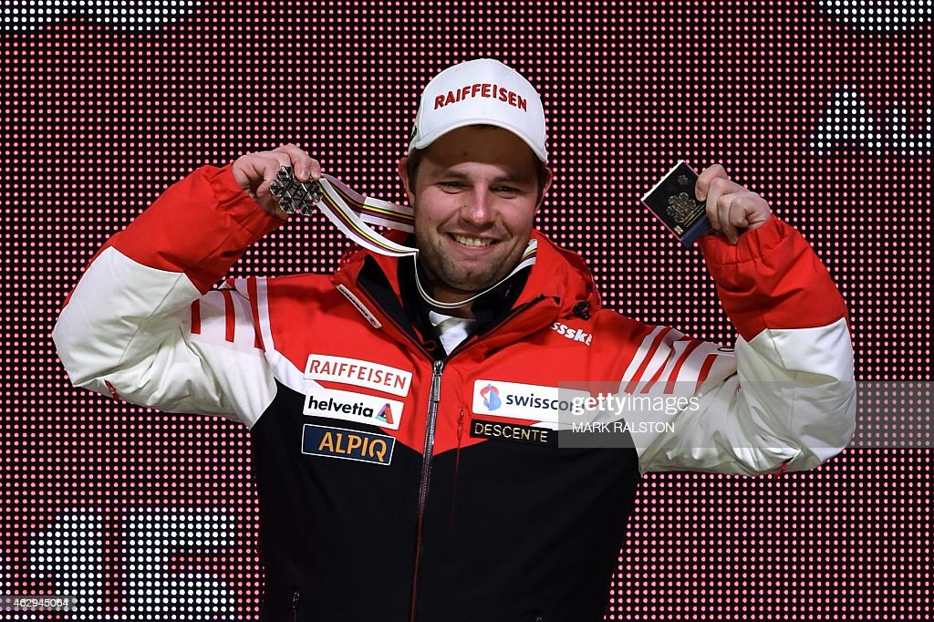 Bronze medalist Switzerland's <a gi-track='captionPersonalityLinkClicked' href=/galleries/search?phrase=Beat+Feuz&family=editorial&specificpeople=4193254 ng-click='$event.stopPropagation()'>Beat Feuz</a> reacts during the medal ceremony of the 2015 World Alpine Ski Championships men's Downhill, on February 7, 2015 in Vail, Colorado. AFP PHOTO / MARK RALSTON