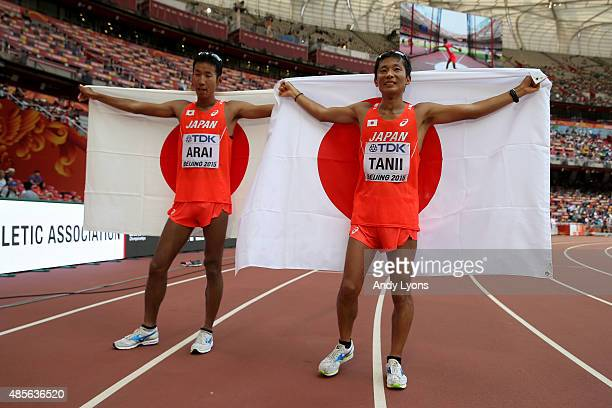 Bronze medalist Takayuki Tanii of Japan celebrates with Hirooki Arai of Japan after crossing the finish line in the Men's 50km Race Walk final during...