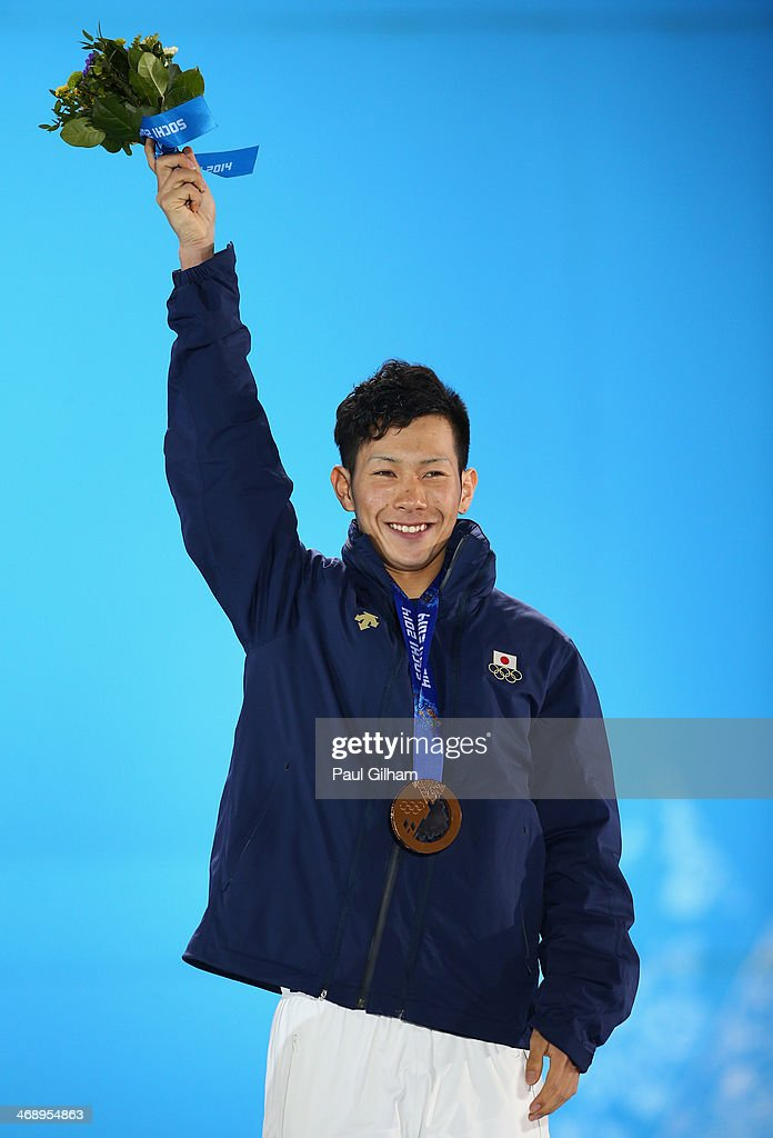 Bronze medalist <a gi-track='captionPersonalityLinkClicked' href=/galleries/search?phrase=Taku+Hiraoka&family=editorial&specificpeople=7152528 ng-click='$event.stopPropagation()'>Taku Hiraoka</a> of Japan celebrates during the medal ceremony for the Snowboard Men's Halfpipe on day five of the Sochi 2014 Winter Olympics at Medals Plaza on February 12, 2014 in Sochi, Russia.