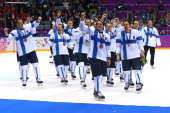 Bronze medalist Teemu Selanne of Finland celebrates with teammates after defeating the United States 50 during the Men's Ice Hockey Bronze Medal Game...