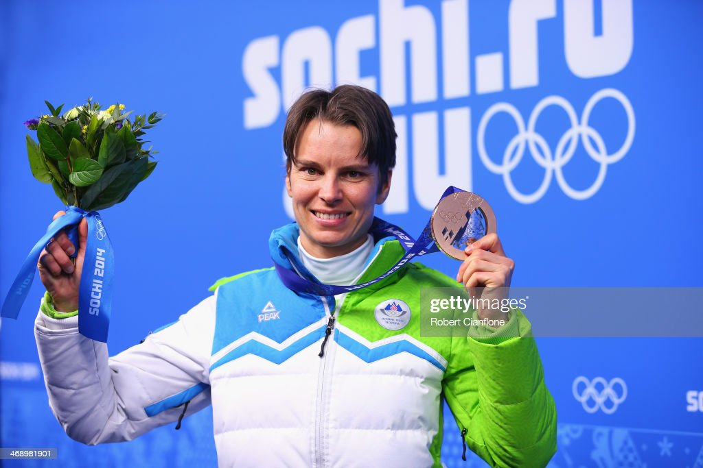 Bronze medalist <a gi-track='captionPersonalityLinkClicked' href=/galleries/search?phrase=Teja+Gregorin&family=editorial&specificpeople=876933 ng-click='$event.stopPropagation()'>Teja Gregorin</a> of Slovenia celebrates during the medal ceremony for the Women's 10 km Pursuit on day five of the Sochi 2014 Winter Olympics at Medals Plaza on February 12, 2014 in Sochi, Russia.