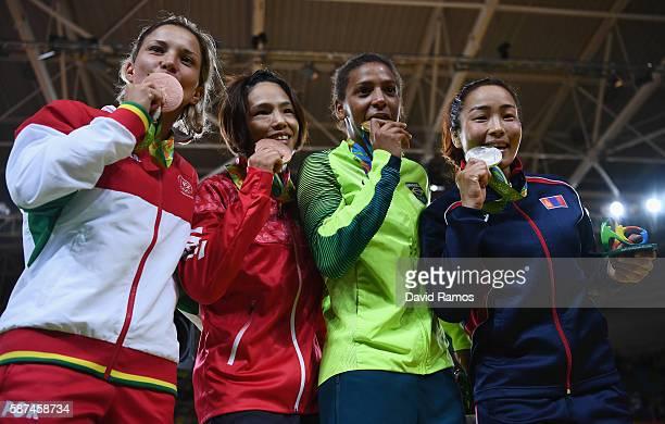Bronze medalist Telma Monteiro of Portugal bronze medalist Kaori Matsumoto of Japan gold medalist Rafaela Silva of Brazil and silver medalist Sumiya...