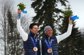 Bronze medalist Thomas Clarion of France and guide Julien Bourla pose during the medal ceremony for the Men's Cross Country 10km Free – Visually...