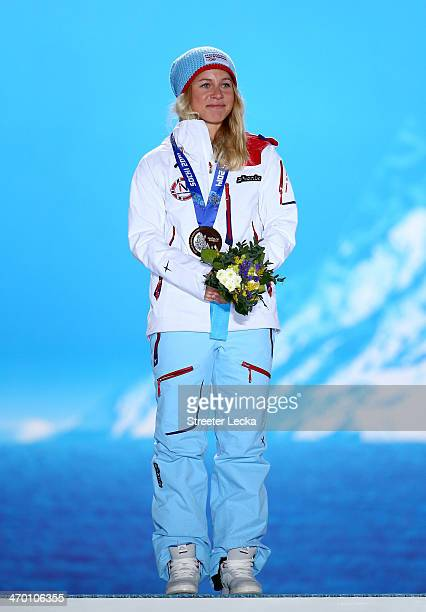 Bronze medalist Tiril Eckhoff of Norway celebrates on the podium during the medal ceremony for the Women's 125 km Mass Start on day 11 of the Sochi...