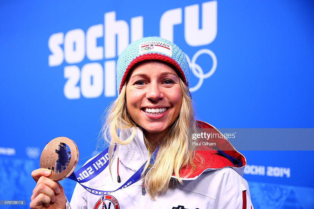 Bronze medalist <a gi-track='captionPersonalityLinkClicked' href=/galleries/search?phrase=Tiril+Eckhoff&family=editorial&specificpeople=10023336 ng-click='$event.stopPropagation()'>Tiril Eckhoff</a> of Norway celebrates on the podium during the medal ceremony for the Women's 12.5 km Mass Start on day 11 of the Sochi 2014 Winter Olympics at Medals Plaza on February 18, 2014 in Sochi, Russia.