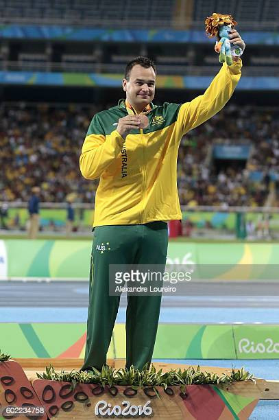 Bronze medalist Todd Hodgetts of Australia celebrate on the podium at the medal ceremony for the Menâs Shot Put â F20 Final during day 3 of the Rio...