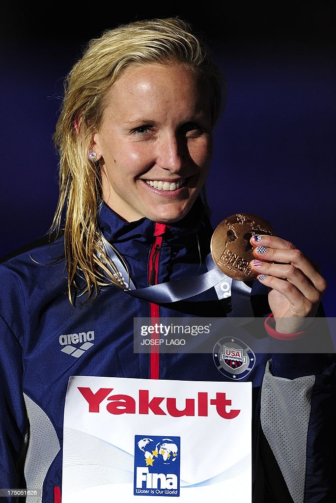 Bronze medalist US swimmer Jessica Hardy poses on the podium with her medal during the award ceremony of the women's 100-metre breaststroke swimming event in the FINA World Championships at Palau Sant Jordi in Barcelona on July 30, 2013. AFP PHOTO / JOSEP LAGO