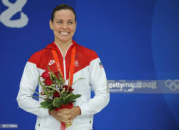 Bronze medalist US swimmer Natalie Coughlin stands on the podium for the women's 200m individual medley swimming final medal ceremony at the National...