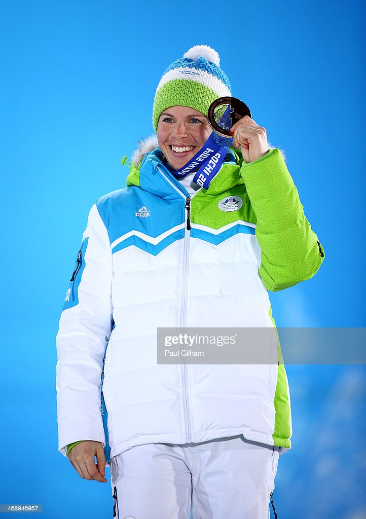Bronze medalist <a gi-track='captionPersonalityLinkClicked' href=/galleries/search?phrase=Vesna+Fabjan&family=editorial&specificpeople=817752 ng-click='$event.stopPropagation()'>Vesna Fabjan</a> of Slovenia celebrates during the medal ceremony for the Women's 10 km Pursuit on day five of the Sochi 2014 Winter Olympics at Medals Plaza on February 12, 2014 in Sochi, Russia.
