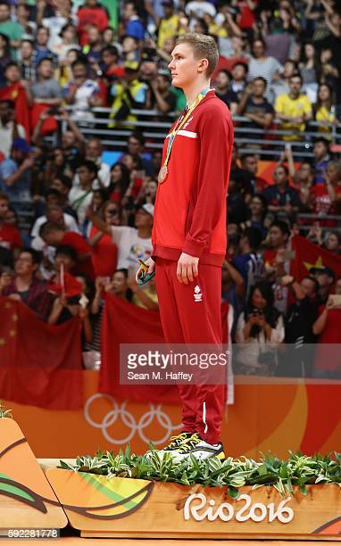 Bronze medalist Viktor Axelson of Denmark poses on the podium during the medal ceremony for the Men's Singles Badminton on Day 15 of the Rio 2016...