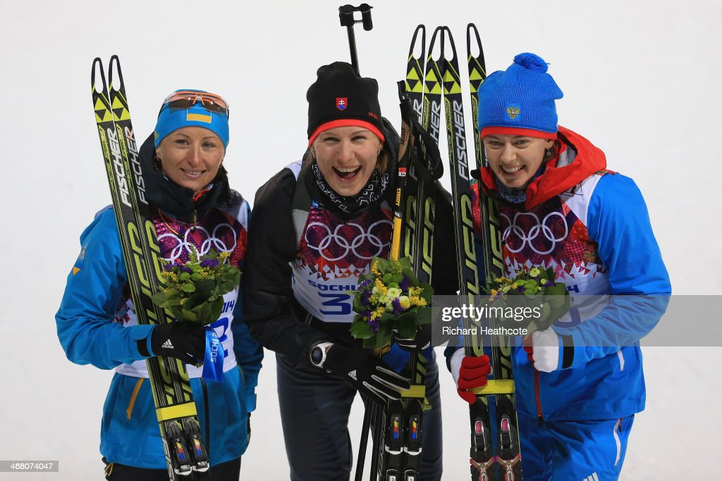 Bronze medalist <a gi-track='captionPersonalityLinkClicked' href=/galleries/search?phrase=Vita+Semerenko&family=editorial&specificpeople=4894891 ng-click='$event.stopPropagation()'>Vita Semerenko</a> of Ukraine, gold medalist <a gi-track='captionPersonalityLinkClicked' href=/galleries/search?phrase=Anastasiya+Kuzmina&family=editorial&specificpeople=6738529 ng-click='$event.stopPropagation()'>Anastasiya Kuzmina</a> of Slovakia and silver medalist <a gi-track='captionPersonalityLinkClicked' href=/galleries/search?phrase=Olga+Vilukhina&family=editorial&specificpeople=7398357 ng-click='$event.stopPropagation()'>Olga Vilukhina</a> of Russia pose after the flower ceremony after the Women's 7.5 km Sprint during day two of the Sochi 2014 Winter Olympics at Laura Cross-country Ski & Biathlon Center on February 9, 2014 in Sochi, Russia.