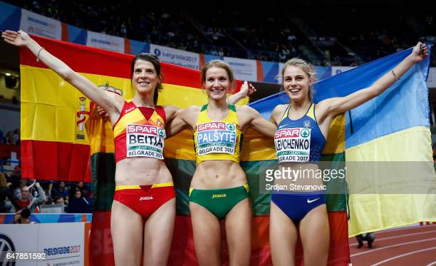Bronze medalist Yuliya Levchenko of Ukraine gold medalist Airine Palsyte of Lithuania and silver medalist Ruth Beitia of Spain celebrate following...