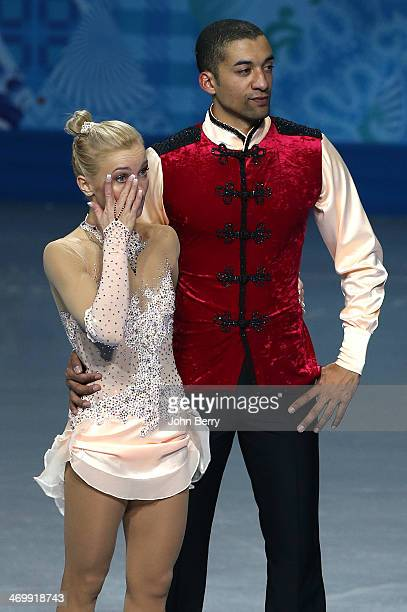 Bronze medalists Aliona Savchenko and Robin Szolkowy of Germany pose during the flower ceremony after the Figure Skating Pairs Free Skating during...