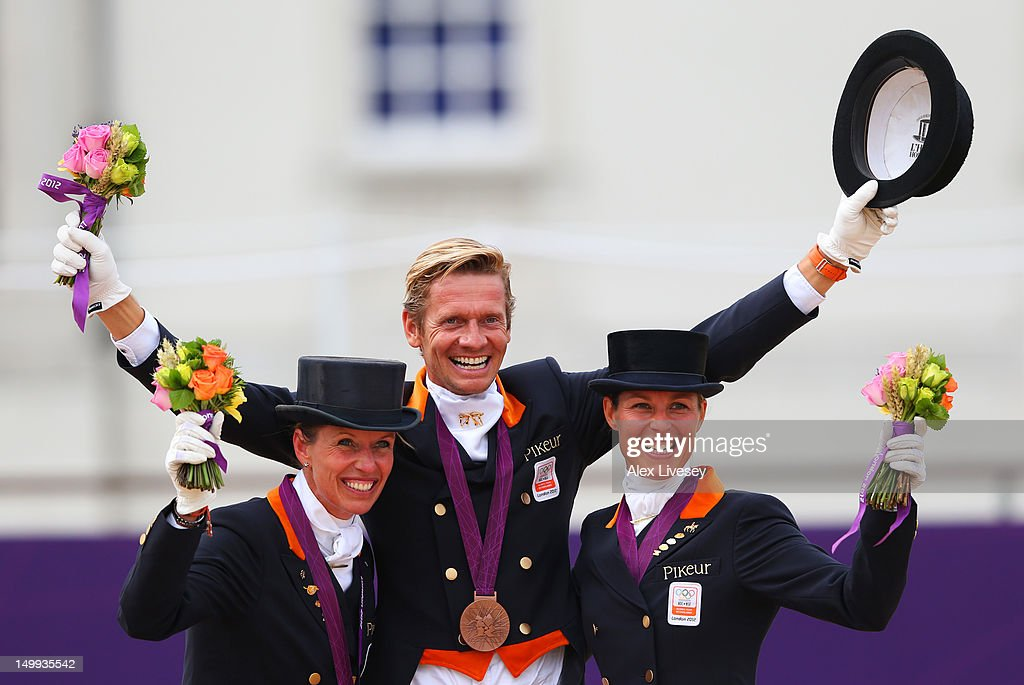 Bronze medalists Anky Van Grunsven Edward Gal and Adelinde Cornelissen of Netherlands celebrate with their medals during the medal cerermony for the...