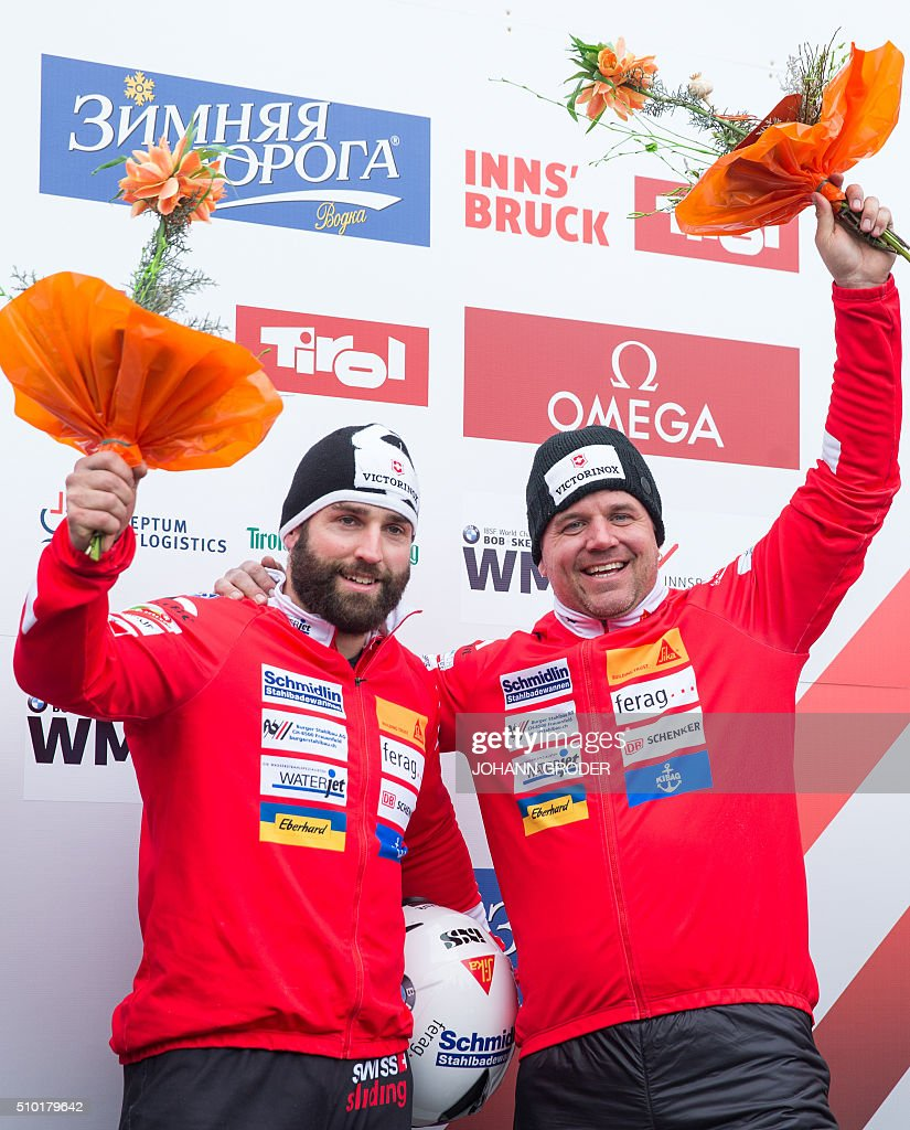 Bronze medalists Beat Hefti and Alex Baumann of Switzerland place third in the two-men Bobsleigh event of the Bobsleigh and Skeleton World Championships in Innsbruck/Igls, Austria, February 14, 2016. / AFP / APA / Johann Groder / Austria OUT