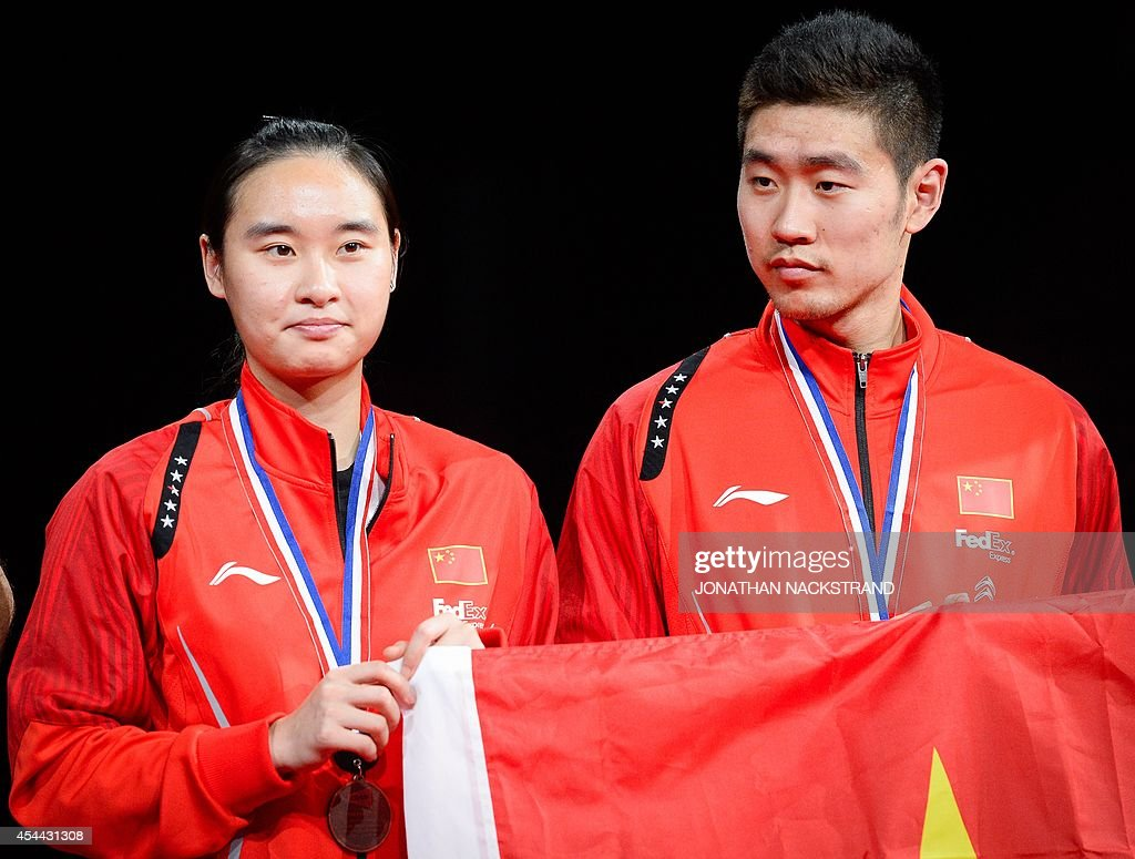 Bronze medalists China s Bao Yixin L and Liu Cheng react during